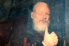 WikiLeaks founder Julian <HIT>Assange</HIT> arrives at the Westminster Magistrates Court, after he was arrested in London