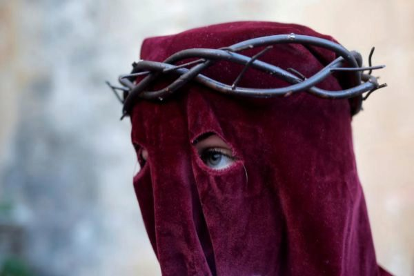 A woman, penitent of Los <HIT>Gitanos</HIT> brotherhood, leaves a church as she takes part in a procession during Holy Week in Ronda