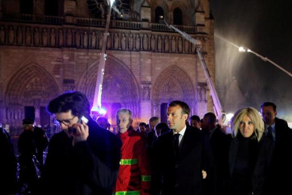 French President Emmanuel <HIT>Macron</HIT> and his wife Brigitte walk...
