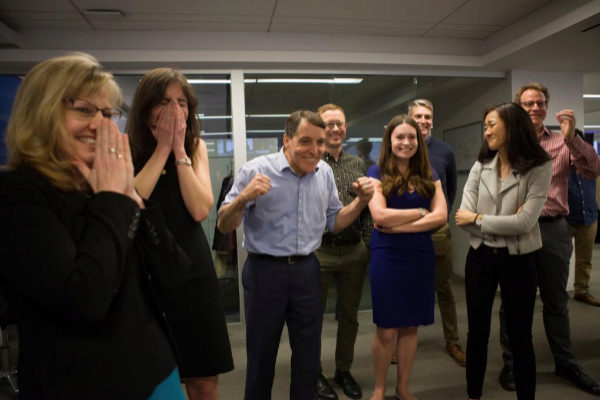 The Wall Street Journal staff celebrates the paper's <HIT>Pulitzer</HIT> Prize win for National Reporting in their newsroom in New York