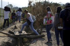 People walk along a pathway near the Colombian-Venezuelan border in the outskirts of Cucuta, Colombia February 25, 2019. REUTERS/<HIT>Marco</HIT> <HIT>Bello</HIT> - RC1D590A9710