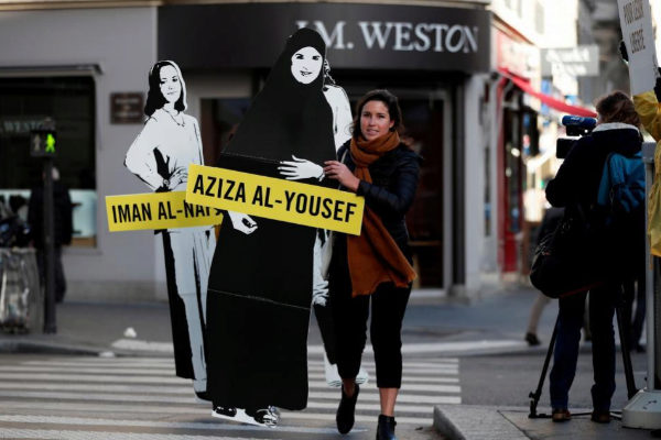 FILE PHOTO: Demonstrators from Amnesty International protest outside...