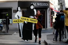FILE PHOTO: Demonstrators from Amnesty International protest outside the Saudi Arabian Embassy on International Women's day in Paris