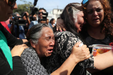 Supporters of Peru's former President <HIT>Alan</HIT> <HIT>Garcia</HIT> react after the announcement that <HIT>Garcia</HIT> died in a hospital after shooting himself, in Lima