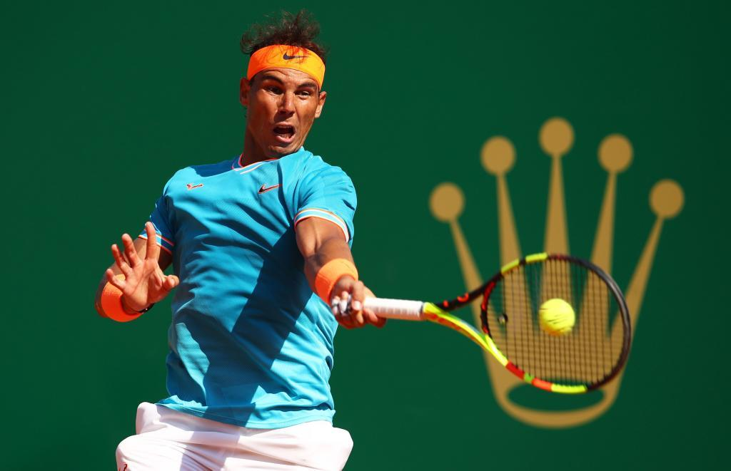 MONTE-CARLO, MONACO - APRIL 17: Rafael <HIT>Nadal</HIT> of Spain plays a forehand against Roberto Bautista Agut of Spain in their second round match during day four of the Rolex Monte-Carlo Masters at Monte-Carlo Country Club on April 17, 2019 in Monte-Carlo, Monaco. (Photo by Clive Brunskill/Getty Images) ***BESTPIX***