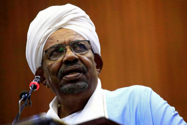 FILE PHOTO: Sudanese President Omar al-Bashir delivers a speech inside...