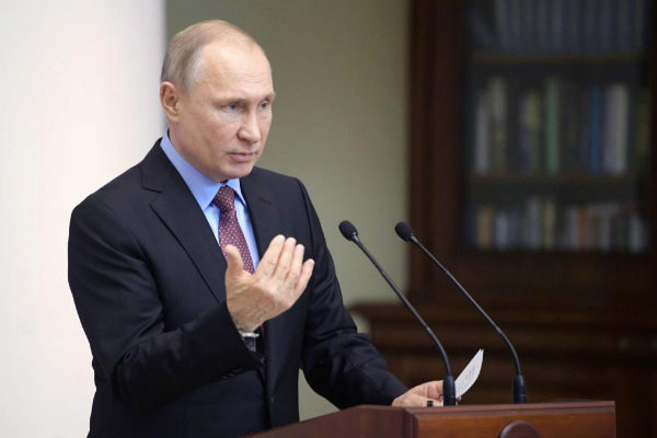 Russian President <HIT>Putin</HIT> delivers a speech during a meeting...