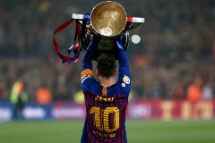 Barcelona's Argentinian forward Lionel <HIT>Messi</HIT> celebrates with the Liga trophy as Barcelona won their 26th league title after the Spanish League football match between Barcelona and Levante at the Camp Nou stadium in Barcelona on April 27, 2019. (Photo by PAU BARRENA / AFP)