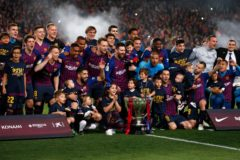 Barcelona's players celebrate with the <HIT>Liga</HIT> trophy after winning the club's 26th league title at the end of the Spanish League football match between Barcelona and Levante at the Camp Nou stadium in Barcelona on April 27, 2019. (Photo by PAU BARRENA / AFP)