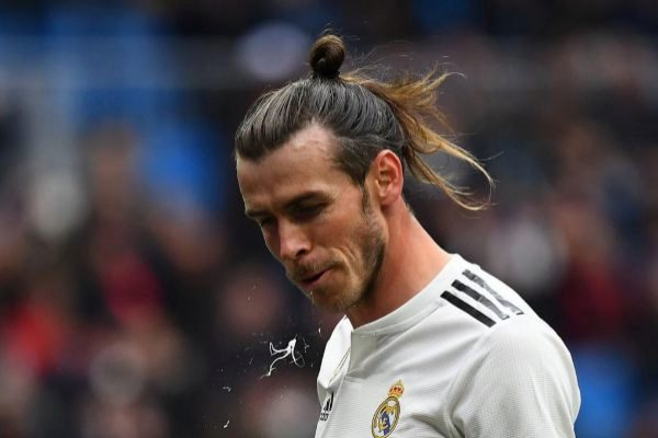 Real Madrid's Welsh forward Gareth <HIT>Bale</HIT> spits during the Spanish League football match between Real Madrid and Athletic Bilbao at the Santiago Bernabeu Stadium in Madrid on April 21, 2019. (Photo by GABRIEL BOUYS / AFP)