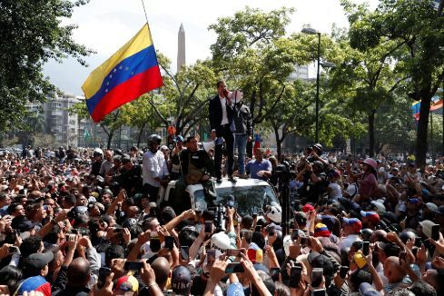 Venezuelan opposition leader Juan <HIT>Guaido</HIT>, who many nations have recognised as the country's rightful interim ruler, talks to supporters in Caracas