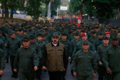 """This handout picture released by Miraflores Palace press office shows Venezuela's President Nicolas <HIT>Maduro</HIT> (C) waving military troops accompanied by Defense Minister Vladimir Padrino (L) at the """"Fuerte Tiuna"""" in Caracas, Venezuela on May 2, 2019. - <HIT>Maduro</HIT> attends a """"march to reaffirm the absolute loyalty"""" of the Venezuelan Army, as opposition leader Juan Guaido continues making calls to oust his government. (Photo by HO / Presidency/JHONN ZERPA / AFP)"""