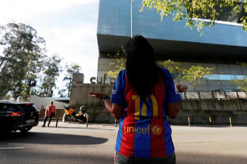 Concecao Alves, supporter of Barcelona, prays outside CUF hospital where Spanish soccer player Iker <HIT>Casillas</HIT> recovers after he suffered a heart attack during a training session in Porto