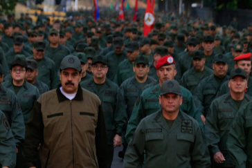 "This handout picture released by Miraflores Palace press office shows Venezuela's President Nicolas <HIT>Maduro</HIT> (C) waving military troops accompanied by Defense Minister Vladimir Padrino (L) at the ""Fuerte Tiuna"" in Caracas, Venezuela on May 2, 2019. - <HIT>Maduro</HIT> attends a ""march to reaffirm the absolute loyalty"" of the Venezuelan Army, as opposition leader Juan Guaido continues making calls to oust his government. (Photo by HO / Presidency/JHONN ZERPA / AFP)"