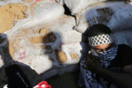 Palestinian demonstrator take cover during a protest at the Israel-<HIT>Gaza</HIT> border fence, in the southern <HIT>Gaza</HIT> Strip