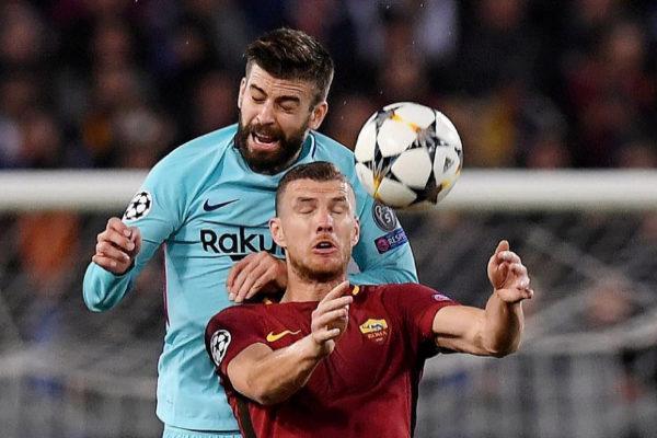 Dzeko y Piqué, la temporada pasada en los cuartos en Roma.