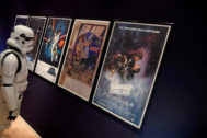 FILE PHOTO: A man wearing a storm trooper costume stands in front of Star <HIT>Wars</HIT> posters belonging to costume designer John Mollo, during a photo-call ahead of an auction at Bonhams in central London