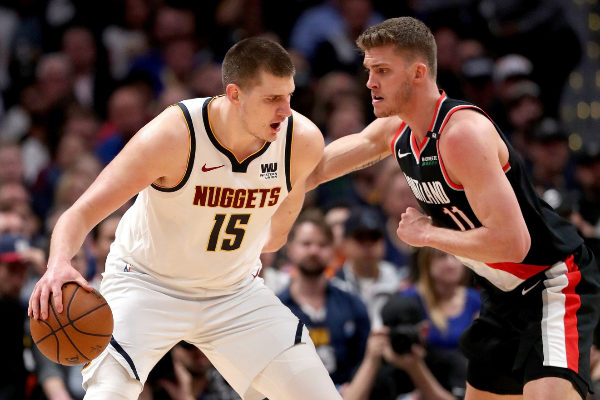 == FOR NEWSPAPERS, INTERNET, TELCOS & TELEVISION USE ONLY == DENVER, COLORADO - MAY 07: Nikola <HIT>Jokic</HIT> #15 of the Denver Nuggets is is guarded by Meyers Leonard #11 of the Portland Trail Blazers after a flagrant foul in the fourth quarter during Game Five of the Western Conference Semi-Finals of the 2019 NBA Playoffs at the Pepsi Center on May 7, 2019 in Denver, Colorado. NOTE TO USER: User expressly acknowledges and agrees that, by downloading and or using this photograph, User is consenting to the terms and conditions of the Getty Images License Agreement. Matthew Stockman/Getty Images/AFP