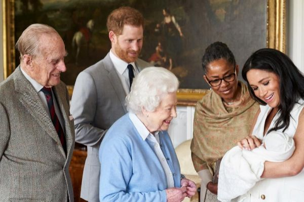 Prince Harry and <HIT>Meghan</HIT> introduce their baby son