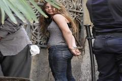 María Gombau (madre de los niños), cuando fue detenida en 2011, tras una protesta antisistema.