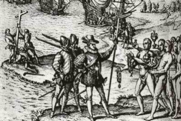 Grabado de 1590 que representa a Colón desembarcando en América.