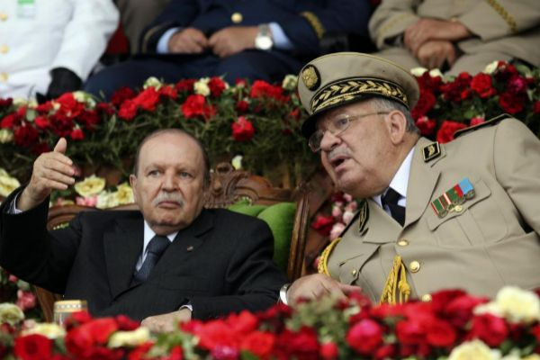 Algeria's President and head of the Armed Forces Abdelaziz Bouteflika (L) gestures while talking with Army Chief of Staff General Ahmed <HIT>Gaid</HIT> <HIT>Salah</HIT> during a graduation ceremony of the 40th class of the trainee army officers at a Military Academy in Cherchell 90 km west of Algiers June 27, 2012. REUTERS/Ramzi Boudina (ALGERIA - Tags: MILITARY POLITICS) - GM1E86S081001