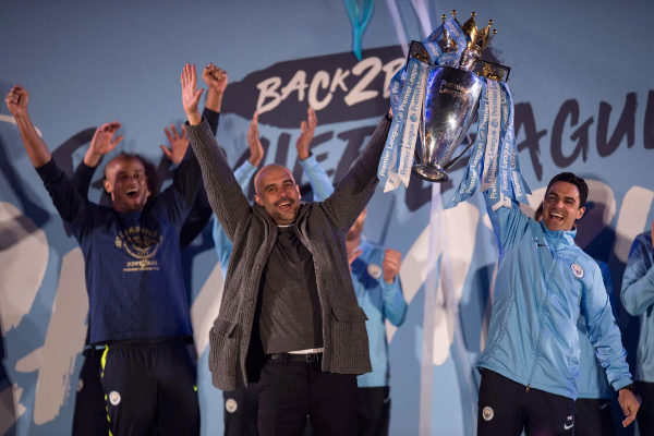 Manchester City's Spanish manager Pep <HIT>Guardiola</HIT> (C), Manchester City assistant coach Mikel Arteta (R) and Manchester City's Belgian defender Vincent Kompany (L) show the Premier League trophy to supporters outside the Etihad Stadium in Manchester, northern England on May 12, 2019. - Manchester City held off a titanic challenge from Liverpool to become the first side in a decade to retain the Premier League on Sunday by coming from behind to beat Brighton 4-1 on Sunday. (Photo by Oli SCARFF / AFP)