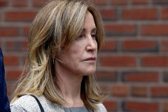 Actror <HIT>Felicity</HIT> Huffman leaves the federal courthouse in Boston