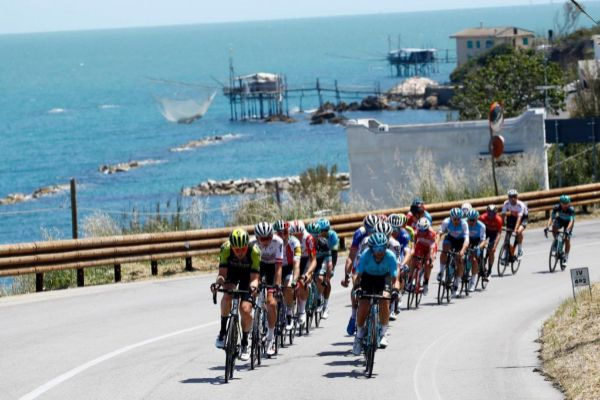 The peleton ride along the coast near Vasto as they take part in stage seven of the 102nd <HIT>Giro</HIT> d'Italia - Tour of Italy - cycle race, 185kms from Vasto to L'Aquila on May 17, 2019. (Photo by Luk BENIES / AFP)