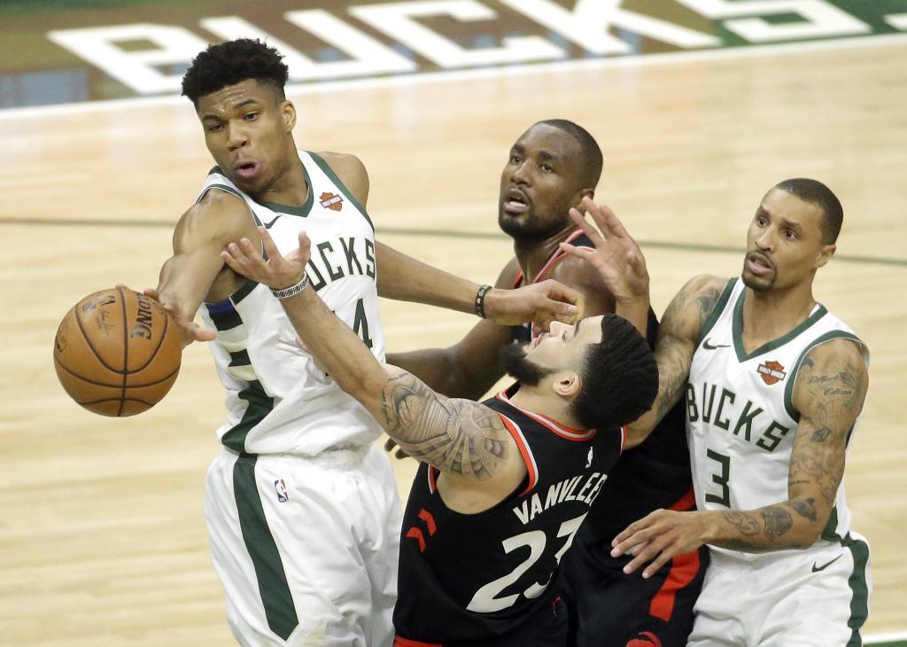 AG3. <HIT>Milwaukee</HIT> (United States).- <HIT>Milwaukee</HIT> Bucks forward Giannis Antetokounmpo (L) of Greece swats the ball away from Toronto Raptors guard Fred VanVleet (C, bottom) during game 2 of the NBA Eastern Conference finals between the Toronto Raptors and the <HIT>Milwaukee</HIT> Bucks at Fiserv Forum in <HIT>Milwaukee</HIT>, Wisconsin, USA, 17 May 2019. (Baloncesto, Grecia, Estados Unidos) EPA/ SHUTTERSTOCK OUT