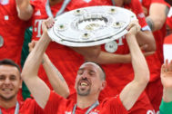 <HIT>Bayern</HIT> Munich players including <HIT>Bayern</HIT> Munich's French midfielder Franck Ribery celebrate with the trophy after the German First division Bundesliga football match FC <HIT>Bayern</HIT> Munich v Eintracht Frankfurt in Munich, southern Germany, on May 18, 2019. (Photo by John MACDOUGALL / AFP) / DFL REGULATIONS PROHIBIT ANY USE OF PHOTOGRAPHS AS IMAGE SEQUENCES AND/OR QUASI-VIDEO