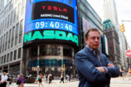 FILE PHOTO: CEO of <HIT>Tesla</HIT> Motors Elon Musk poses during a television interview after his company's initial public offering at the NASDAQ market in New York