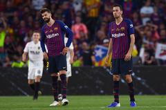 Piqué y Busquets, durante la final de Copa.