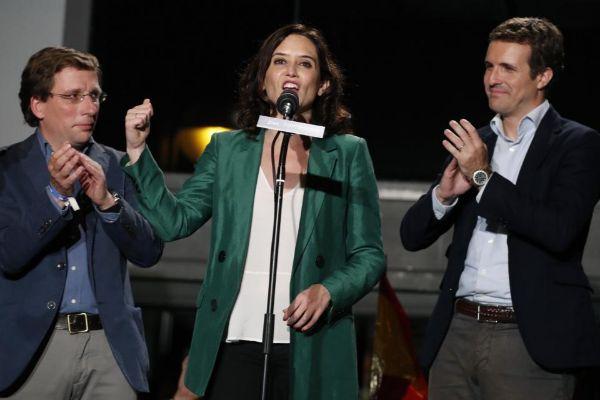 Martínez Almeida, Díaz Ayuso y Casado en Génova.