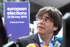 Former Catalan President Carles <HIT>Puigdemont</HIT> talks to the media during European Parliament Elections in Brussels