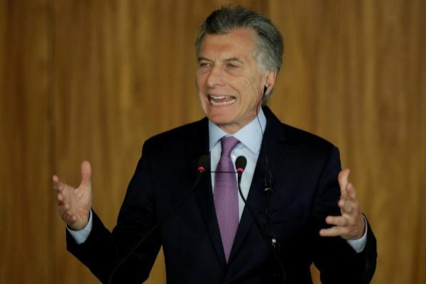 FILE PHOTO: Argentina's President Mauricio <HIT>Macri</HIT> speaks during a meeting with Brazil's President Jair Bolsonaro in Brasilia