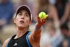 Spain's <HIT>Garbine</HIT> <HIT>Muguruza</HIT> serves to Taylor Townsend of the US during their women's singles first round match on day 1 of The Roland Garrot 2019 French Open tennis tournament in Paris on May 26, 2019. (Photo by Christophe ARCHAMBAULT / AFP)