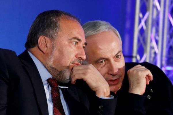 FILE PHOTO: Israel's Prime Minister <HIT>Netanyahu</HIT> converses with former Foreign Minister Lieberman during a campaign rally in Ashdod