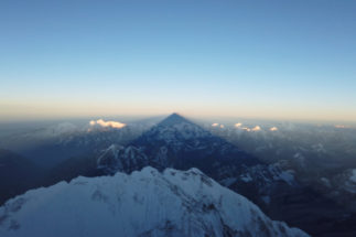 Shadow of <HIT>Everest</HIT> is cast on the mountains during the sunrise in <HIT>Everest</HIT>