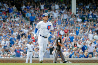 May 25, 2019; Chicago, IL, USA; Chicago Cubs center fielder Albert <HIT>Almora</HIT> Jr. (5) watches his home run against the Cincinnati Reds during the second inning at Wrigley Field. Mandatory Credit: Jon Durr-USA TODAY Sports