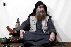 FILE PHOTO: Bearded man with IS leader al-<HIT>Baghdadi</HIT>'s appearance speaks in this screen grab taken from video