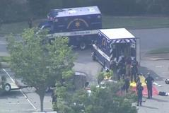 Paramedics prepare a staging area for victims in this still image from video following a shooting incident at the municipal center in <HIT>Virginia</HIT> <HIT>Beach</HIT>
