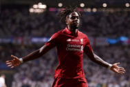 MADRID, SPAIN - JUNE 01: Divock <HIT>Origi</HIT> of Liverpool celebrates after scoring his sides second goal during the UEFA Champions League Final between Tottenham Hotspur and Liverpool at Estadio Wanda Metropolitano on June 01, 2019 in Madrid, Spain. (Photo by Laurence Griffiths/Getty Images)