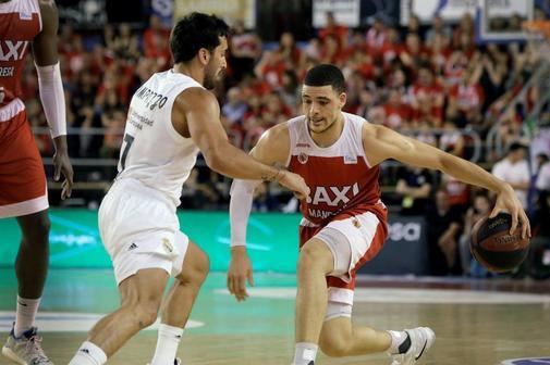 GRAF2709. <HIT>MANRESA</HIT> (BARCELONA).- El jugador del Baxi <HIT>Manresa</HIT> Lund Berg (d) juega una pelota ante Facundo Campazzo, del Real Madrid, durante el segundo partido de los cuartos de final de la Liga ACB de baloncesto disputado esta noche en el Nou Congost de <HIT>Manresa</HIT>.