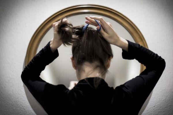 Retrato de una mujer que ha sido maltratada física y psicológicamente