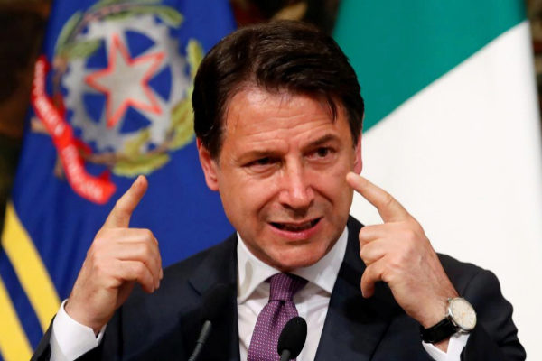 Italian Prime Minister Giuseppe <HIT>Conte</HIT> gestures as he holds...