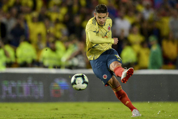 Colombia&apos;s player <HIT>James</HIT> <HIT>Rodriguez</HIT> kicks the ball...