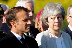 El presidente francés, E.Macron, y la primera ministra británica, T. May.