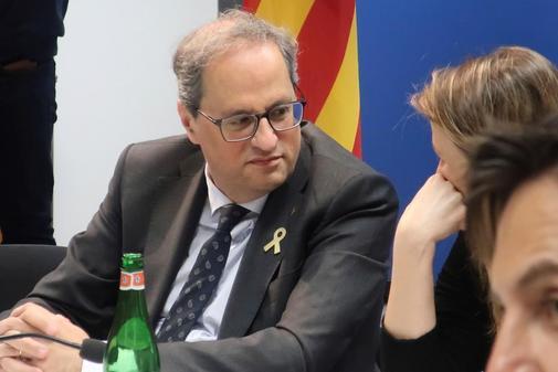 GRAF4422. BRUSELAS.- El presidente de la Generalitat, Quim <HIT>Torra</HIT> (i), conversa con la delegada del Govern en Bruselas, Meritxell Serret, durante la reunión que ha mantenido este jueves en Bruselas con los delegados del Govern en el extranjero.
