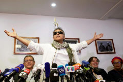 Former commander of Colombia's Marxist Revolutionary Alternative Force of the Common (FARC) Jesus <HIT>Santrich</HIT> reacts during a news conference in FARC's headquarters in Bogota